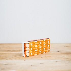 Bild på SOS Barnbyars Tändsticksask orange